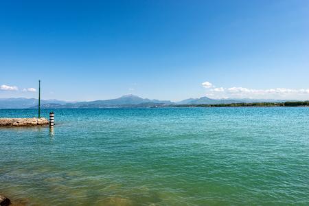 Lago di Garda or Benaco (Lake Garda) near the small town of Peschiera with the italian Alps