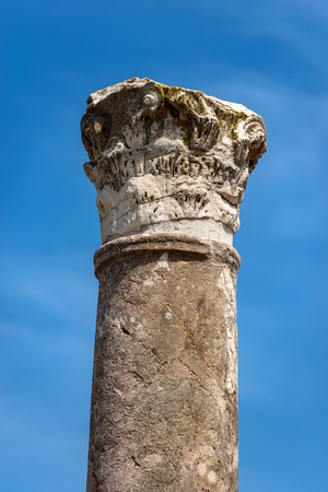 Column with capital in Corinthian style in Ostia Antica, Roman colony founded in the 7th century BC. Reklamní fotografie