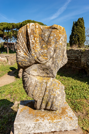 Ancient roman statue with tunic in Ostia Antica, Roman colony founded in the 7th century BC.
