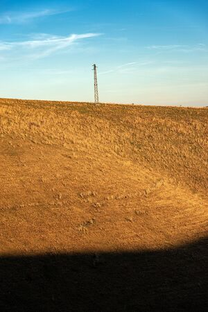 High voltage tower and power line in mountain, Lessinia plateau, Veneto, Italy, Europe