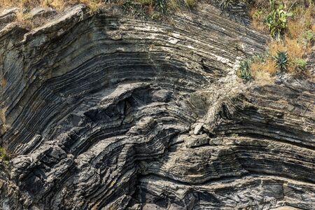 Close-up of a rocky cliff in Vernazza village, Cinque Terre National Park, UNESCO world heritage site. La Spezia province, Liguria, Italy, Europe 版權商用圖片