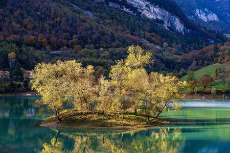 Lago di Tenno, small and beautiful lake in Italian alps with an island. Trento province, Trentino-Alto Adige, Italy, Europe