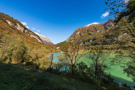 Lago di Tenno in autumn, small beautiful lake in Italian alps (Monte Misone). Trento province, Trentino-Alto Adige, Italy, Europe
