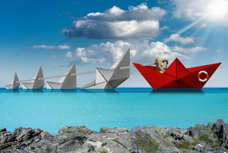 Rescue and leadership concept, a red paper boat of the coast guard rescues four white boats that are sinking in a turquoise sea with blue sky, clouds and sun rays Standard-Bild