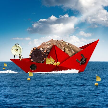 Red paper fishing boat with fishing nets, buoys with flags, winch and anchor, sails in the blue sea. Fishing industry concept