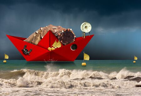 Red paper fishing boat with fishing nets, buoys with flags, winch and anchor, in a rough sea with wave and sky with rain. Fishing industry concept Foto de archivo - 135212168