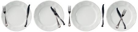 Collection of four white empty plates, serving dishes, with cutlery, fork and table knife. Isolated on white background