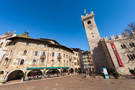TRENTO, TRENTINO ALTO ADIGE, ITALY - MARCH 8th, 2020: Piazza del Duomo, Cathedral square in Trento city with the Civic tower, Praetorian Palace and the frescoed houses Cazuffi Rella