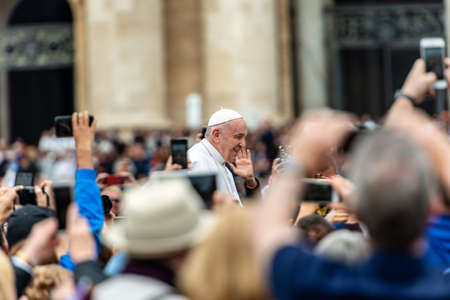 Easter Sunday 2019, Pope Francis I on the popemobile blesses the faithful who try to photograph it with smartphones. St. Peter's Basilica, state of the Vatican City, Europe