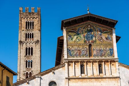 Close-up of the Basilica of San Frediano in Romanesque style (XII century) with the famous mosaic and bell tower. Lucca, Tuscany, Italy, Europe