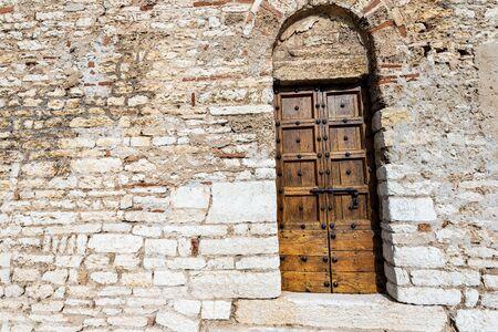 Ancient door of the parish Church of San Giorgio di Valpolicella or Ingannapoltron in Romanesque style (VII - XI century). Verona province, Veneto, Italy, Europe