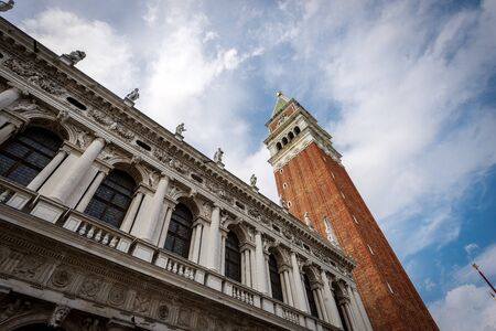 Venice Italy, Piazza San Marco (St Mark square) with the bell tower (Campanile) and the palace of the Biblioteca Nazionale Marciana (Library).