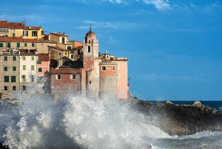 Big waves in the Mediterranean sea. The ancient village of Tellaro during a sea storm. La Spezia, Liguria, Italy, Europe