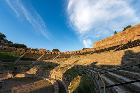 Ancient Greek and Roman theater at sunset in Taormina town, Messina, Sicily island, Italy (II century AD). Europe Stock Photo