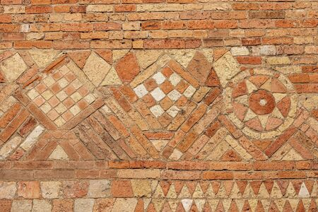 Ancient brick wall of the Basilica of Santo Stefano also known by the name of the Seven Churches in early Christian, Romanesque and Gothic style. Bologna, Emilia-Romagna, Italy, Europe