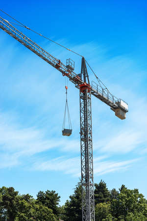 Steel Construction Crane on Blue sky with Clouds and copy space Banco de Imagens