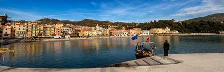 SAN TERENZO, LERICI, LA SPEZIA, ITALY - JANUARY 4, 2013: San Terenzo village with the beach and a fishing boat. Gulf of La Spezia, Liguria, Italy, Europe