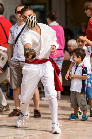 VERONA, ITALY - SEPTEMBER 21, 2014: Tocati, International festival of street games. Athlete of Treia (Marche, Italy) does a demonstration of the game: ball with the bracelet - XVI century