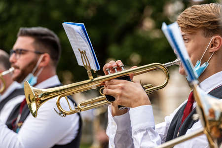 Musicians of a brass band playing the trumpet during a city festival in the center of Padua, Veneto, Italy, Europe.
