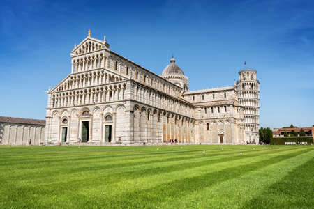 Leaning Tower of Pisa, bell tower of the Cathedral (Duomo di Santa Maria Assunta) in Romanesque style, Piazza or Campo dei Miracoli (Square of Miracles). Tuscany, Italy, Europe