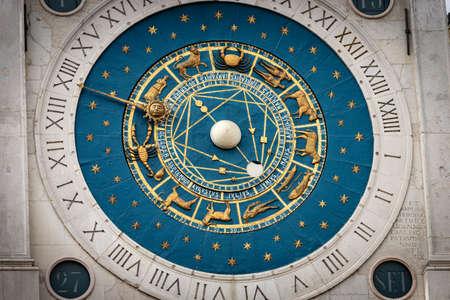 Close-up of the medieval clock tower with zodiac signs in Padua downtown (Padova, XIV century), Piazza dei Signori, Veneto, Italy, Europe. Banco de Imagens