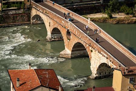 Ponte Pietra (Stone bridge), I century B.C. The oldest Roman monument in Verona, and the river Adige, Veneto, Italy, Europe