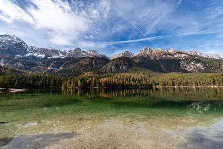 Lago di Tovel, small and beautiful lake in Italian Alps, National Park of Adamello Brenta. Trentino Alto Adige, Trento province, Italy, Europe.