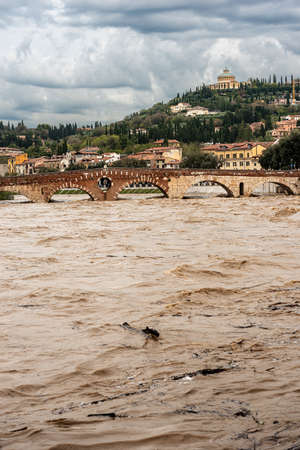 Verona, Ponte Pietra (Stone bridge), I century B.C, and Adige river in flood after several violent storms.