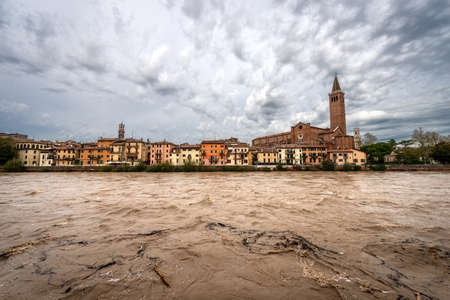 Cityscape of Verona with the church of St. Anastasia (1290-1471) and Adige river in flood after several violent storms. UNESCO world heritage site, Veneto, Italy, Europe Editoriali