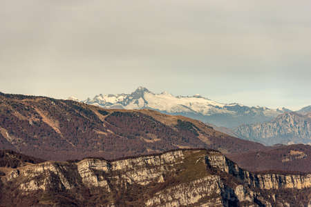 Italian Alps with the mountain range of Monte Baldo and Adamello with the peak of Care Alto photographed from the Lessinia plateau, Veneto, Trentino Alto Adige, Italy, Europe.