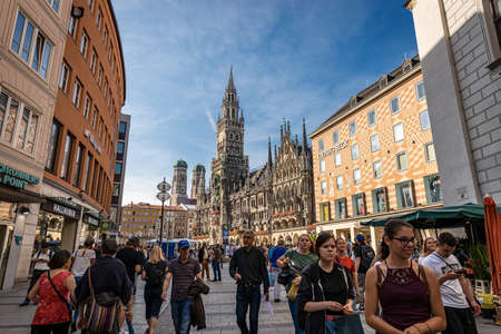 MUNICH, GERMANY - SEPT 6, 2018: Marienplatz, the main square in Munich, Bavaria, Germany. On background the New Town Hall (Neue Rathaus) and the Cathedral. Editoriali
