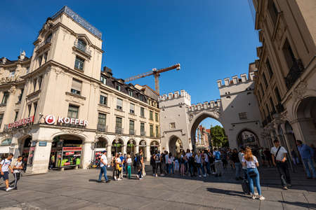 MUNICH, GERMANY - SEPT 6, 2018: Karlstor gate in neo-Gothic style once called Neuhauser Tor, Karlsplatz (Stachus) in downtown. Tourists and locals stroll and shop Editoriali