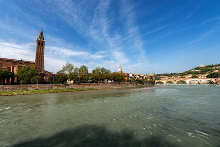 Verona cityscape and the River Adige, Santa Anastasia church, bell tower of the Cathedral and the Ponte Pietra (Stone bridge, I century B.C), Veneto, Italy, Europe. Editoriali