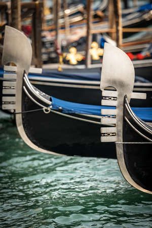 Venice, close-up of two Gondola prows, typical Venetian rowboat, Canal Grande, Veneto, Italy, Europe.
