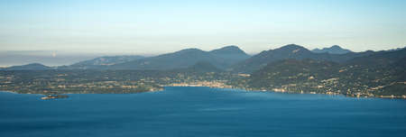 Aerial view of the Lombardy coast of the Lake Garda with the small town of Salo. Italy, Europe.
