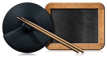 Black cymbal of an electronic drum kit, a pair of wooden drumsticks and an empty blackboard with copy space, isolated on white background with reflections. Percussion instrument concept.