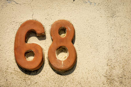 Close-up of house number 68 (sixty-eight) on a stone wall in the small village of Tellaro. Liguria, Italy, Europe Reklamní fotografie