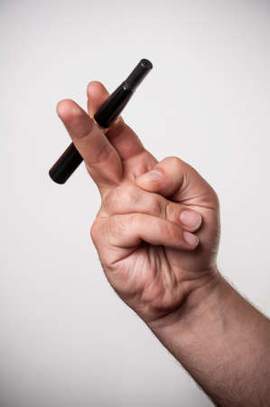atomiser: Man holding an electronic cigar Stock Photo