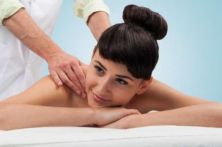 Beautiful brunette woman getting massaged the the wellness spa photo