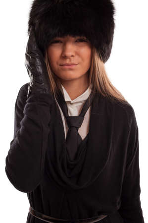 Beautiful woman with a headache wearing a fur hat, black gloves and tie photo