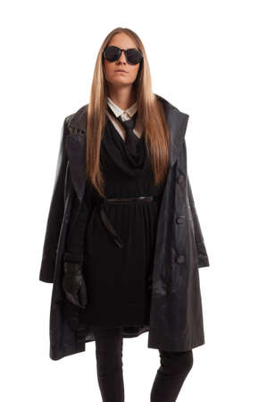 frock coat: Sexy female agent with long hair, leather clothes and sunglasses