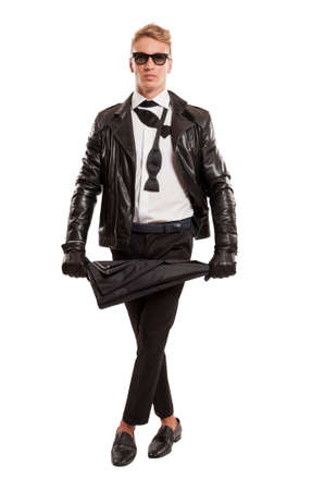 Stylish blond model wearing a leather jacket and bow tie, and holding an umbrella photo