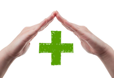 Female doctor hands protecting green cross  Health insurance concept isolated on white background  photo