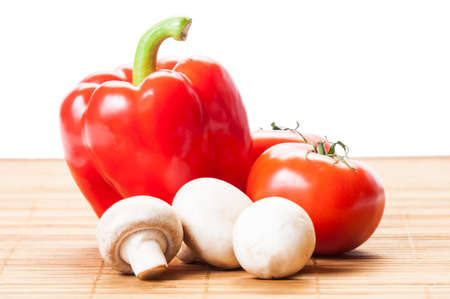Tomatoes, red pepper, and white mushrooms photo