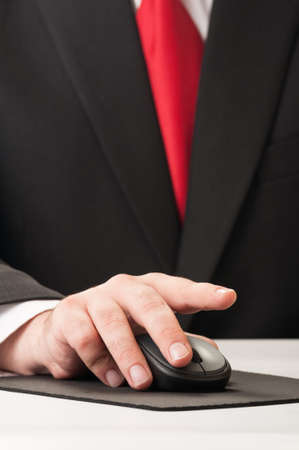 Closeup on a business man hand clicking a wireless mouse photo