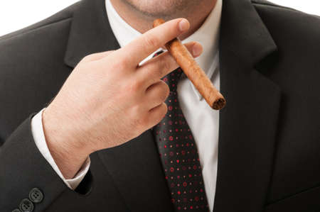 Elegant business man holding a cuban cigar, Business success concept photo