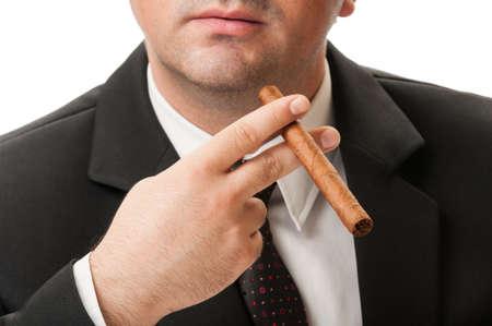 Confident and elegant businessman holding a cuban cigar photo