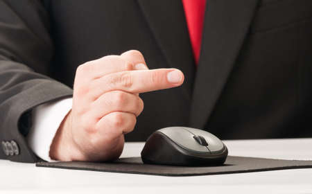 mousepad: Business man using his middle finger concept Stock Photo