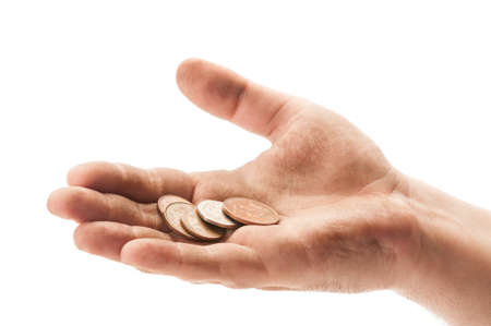Dirty beggar hand with england coins on white background Stock Photo
