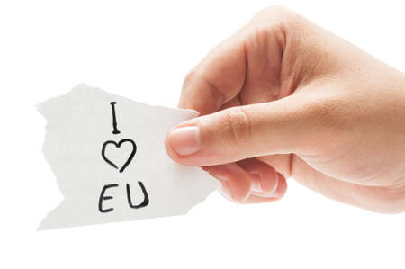 I love EU or European Union, concept  using a hand holding a small piece of paper on white background photo